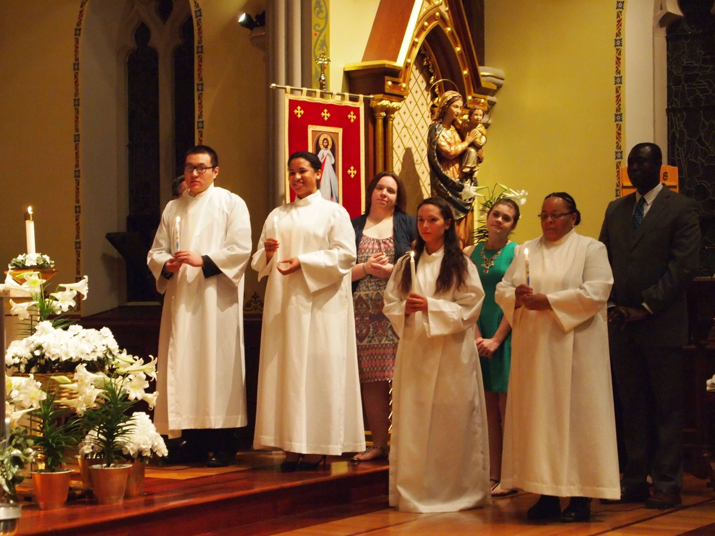 Four Catechumens after receiving the Sacrament of Baptism. Nicole (second from the left) and Holli (second from the right) are involved in Campus Ministry and SPO.