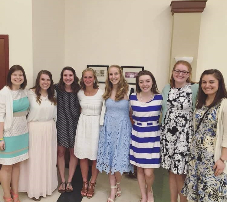 Jalyn, in the middle in white, with the women from SPO who came to support her at the Easter Vigil