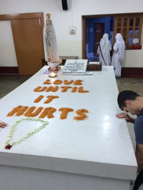 Martin, an spo missionary who went to india with me, prays beside mother teresa's tomb