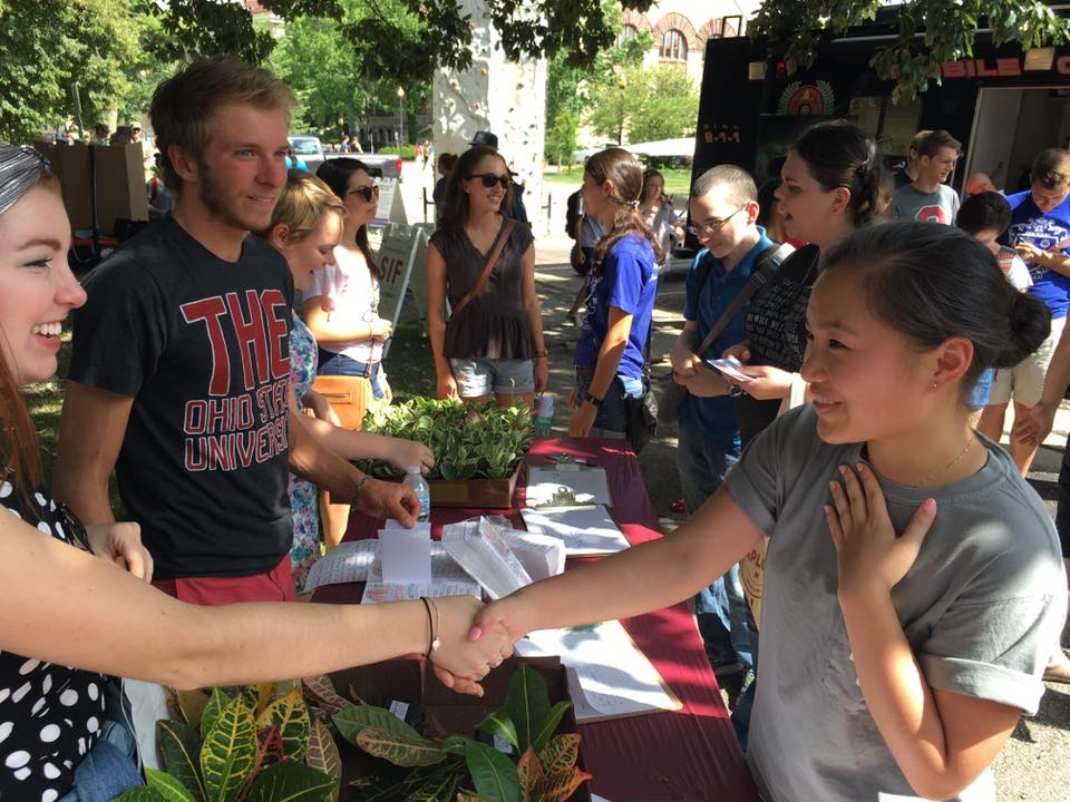 SPO students hand out plants during the involvement fair