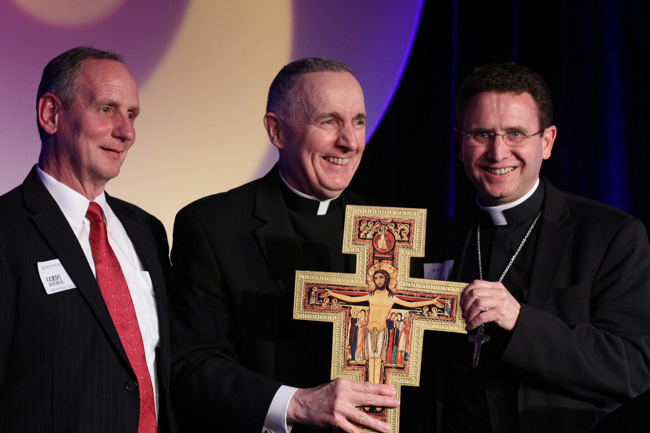 (l-r): Gordy DeMarais, Monsignor Callaghan, and Bishop Andrew Cozzens.
