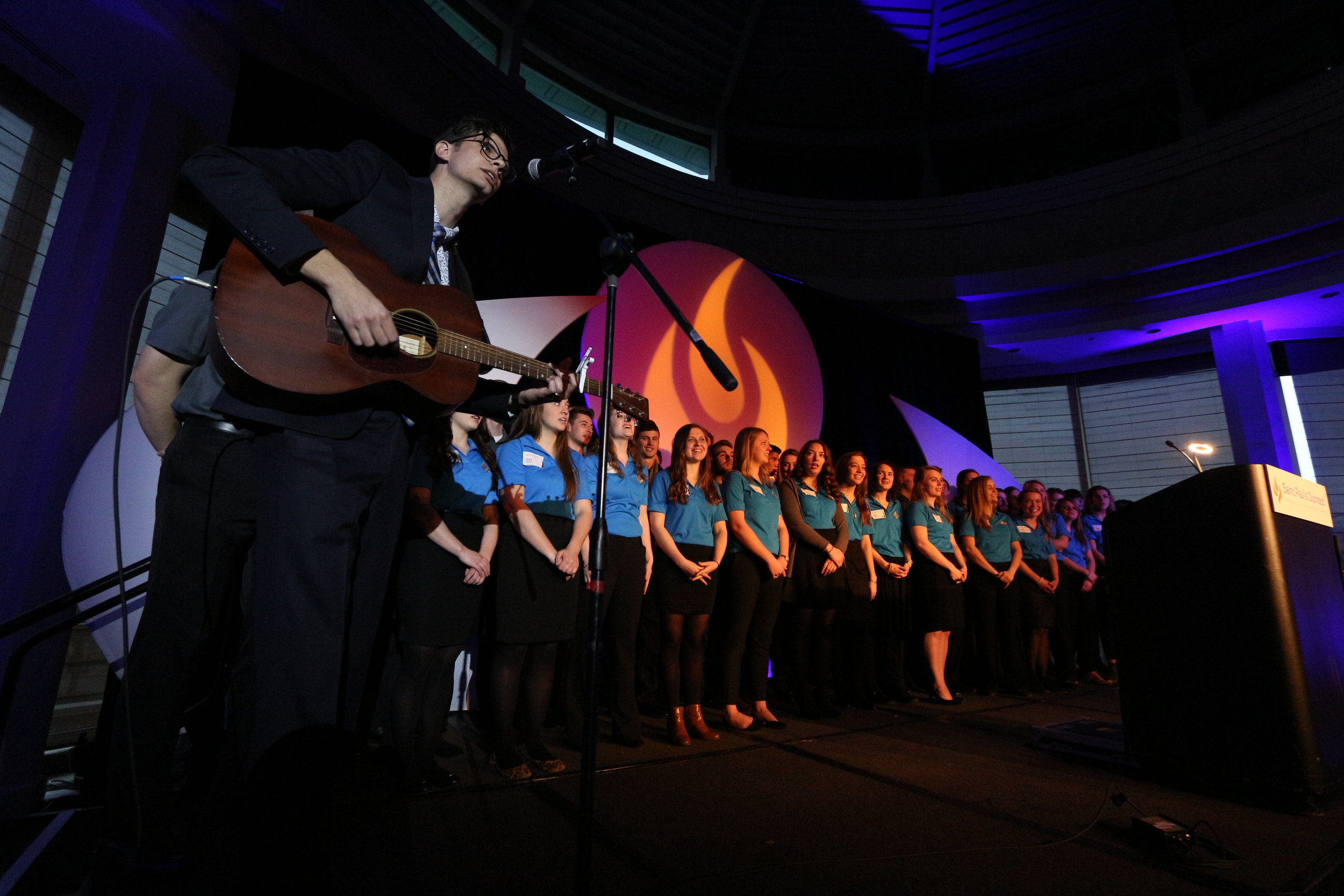 SPO students and staff lined the stage and led a song of worship at the end of the banquet.