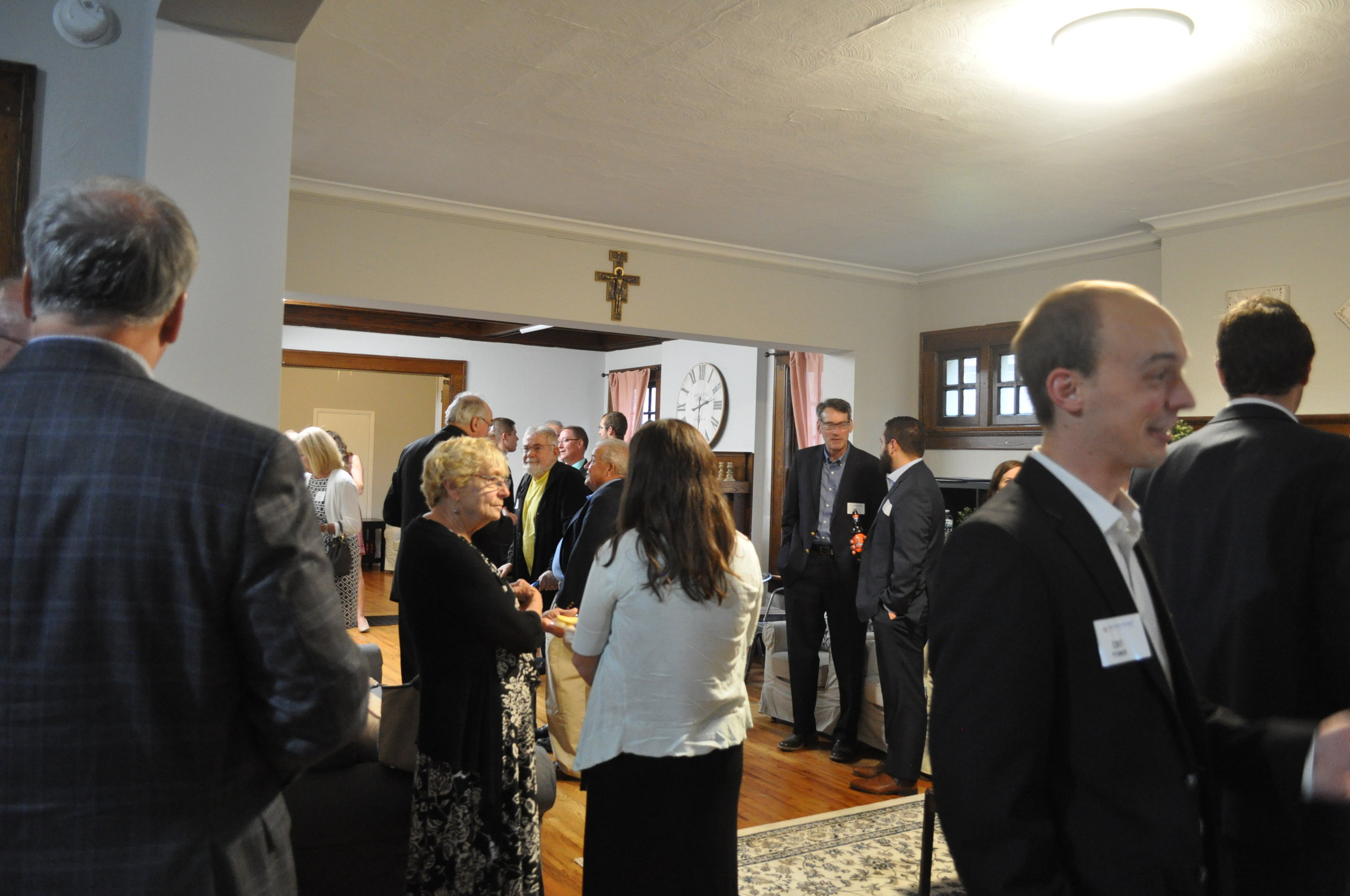 Guests gathered in the living room of Siena