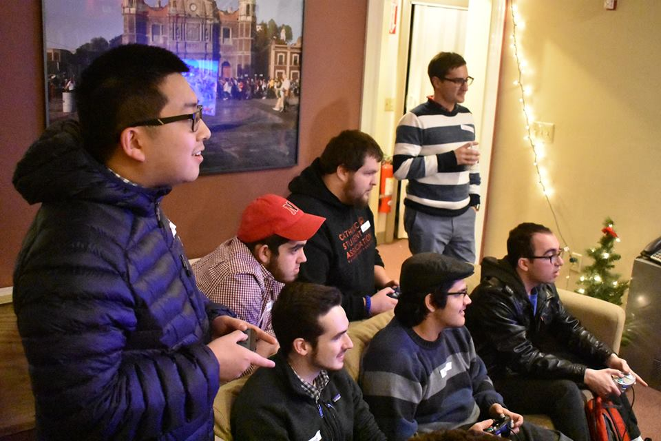 NU students playing Smash Bros. in the basement of the C.C.