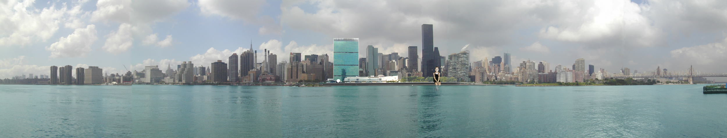 View of Manhattan and the U.N. with 'Sitting Statue'