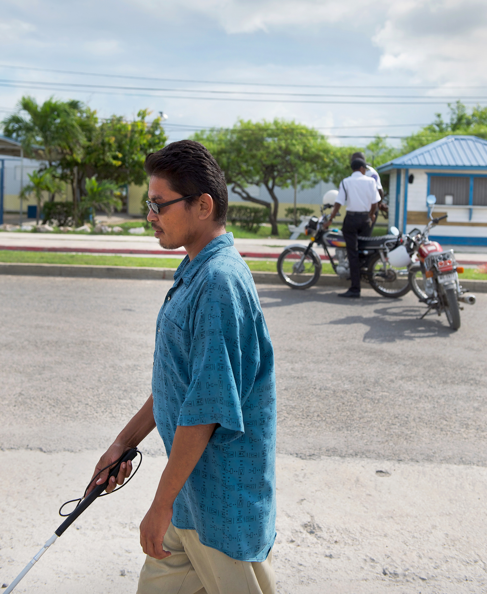 Victor Chan makes his way home from the BCVI Summer Camp. Belize City, Belize.