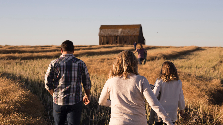 Family Walking In Field.jpg