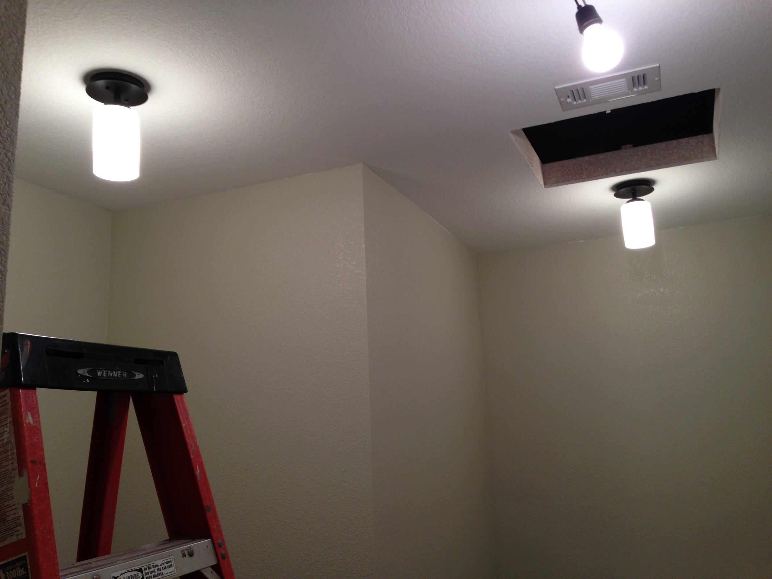 In the middle of the concrete situation we were able to hang some lights.....awwwww!!!!!!!! This is the master closet.