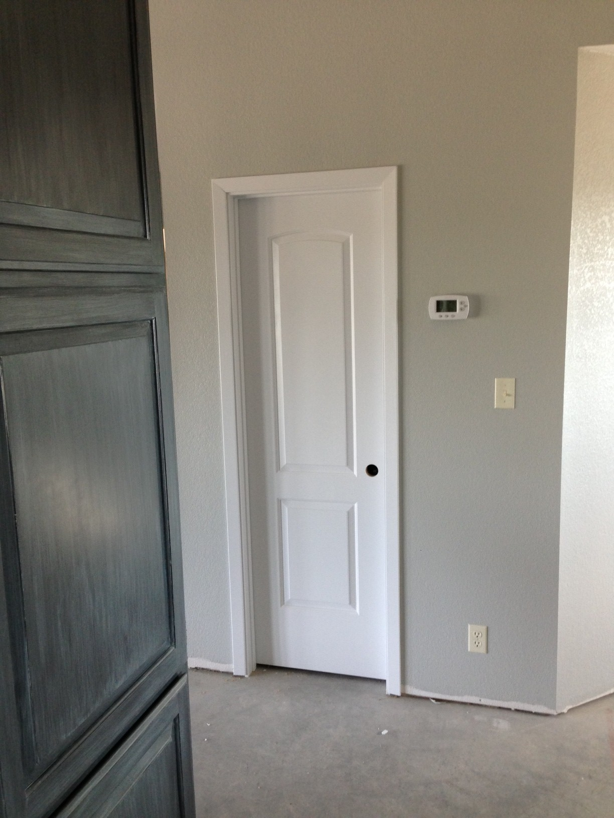Trim around powder bath door. Each door has to have trim and then paint.....every last inch......with two coats........