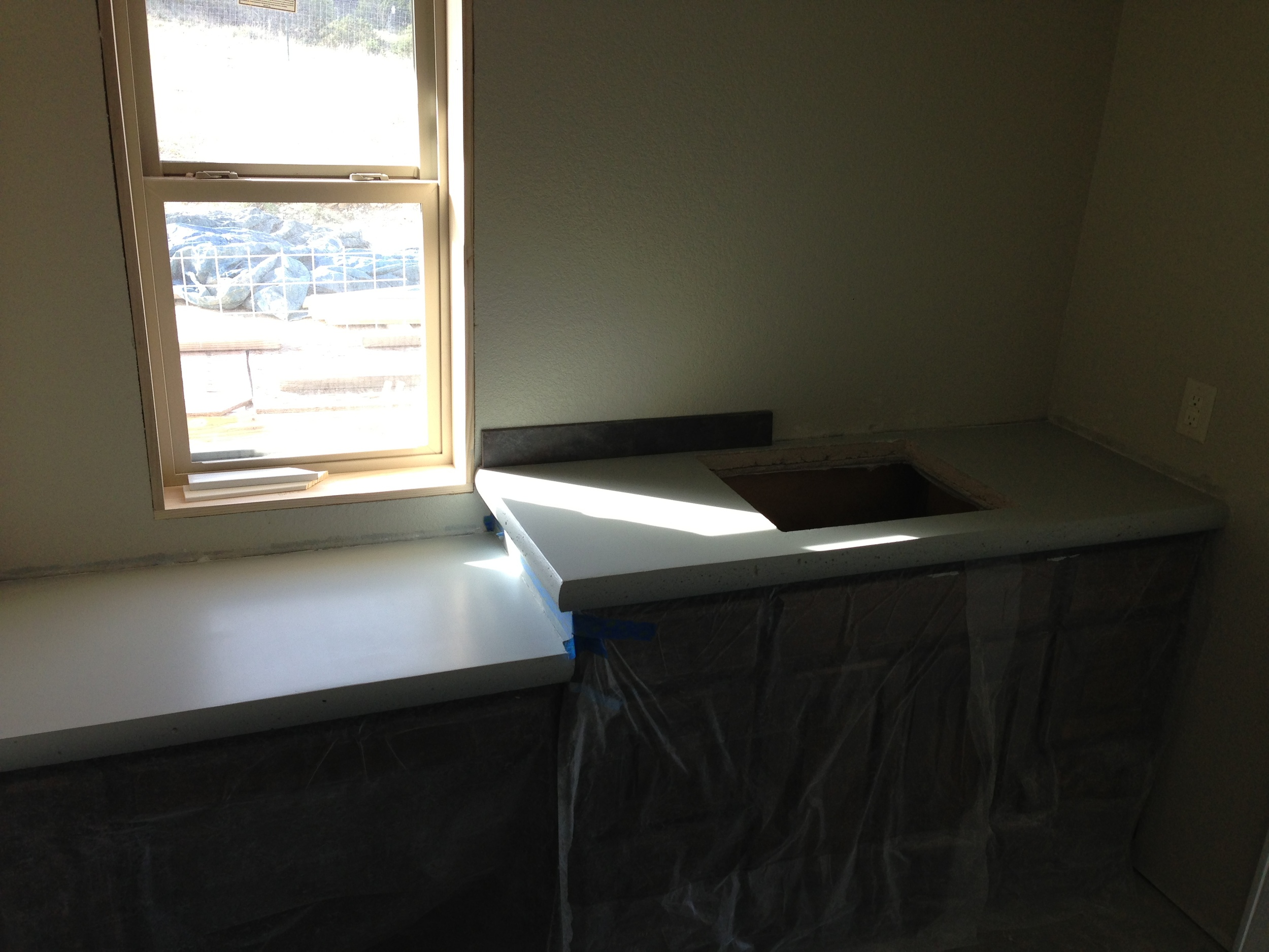 Counter top in the master bath. This one took much more sanding, then paint, and.....you guessed it MORE sanding. This one needs another coat of paint, then sealer, sink, water fixtures and back splash.