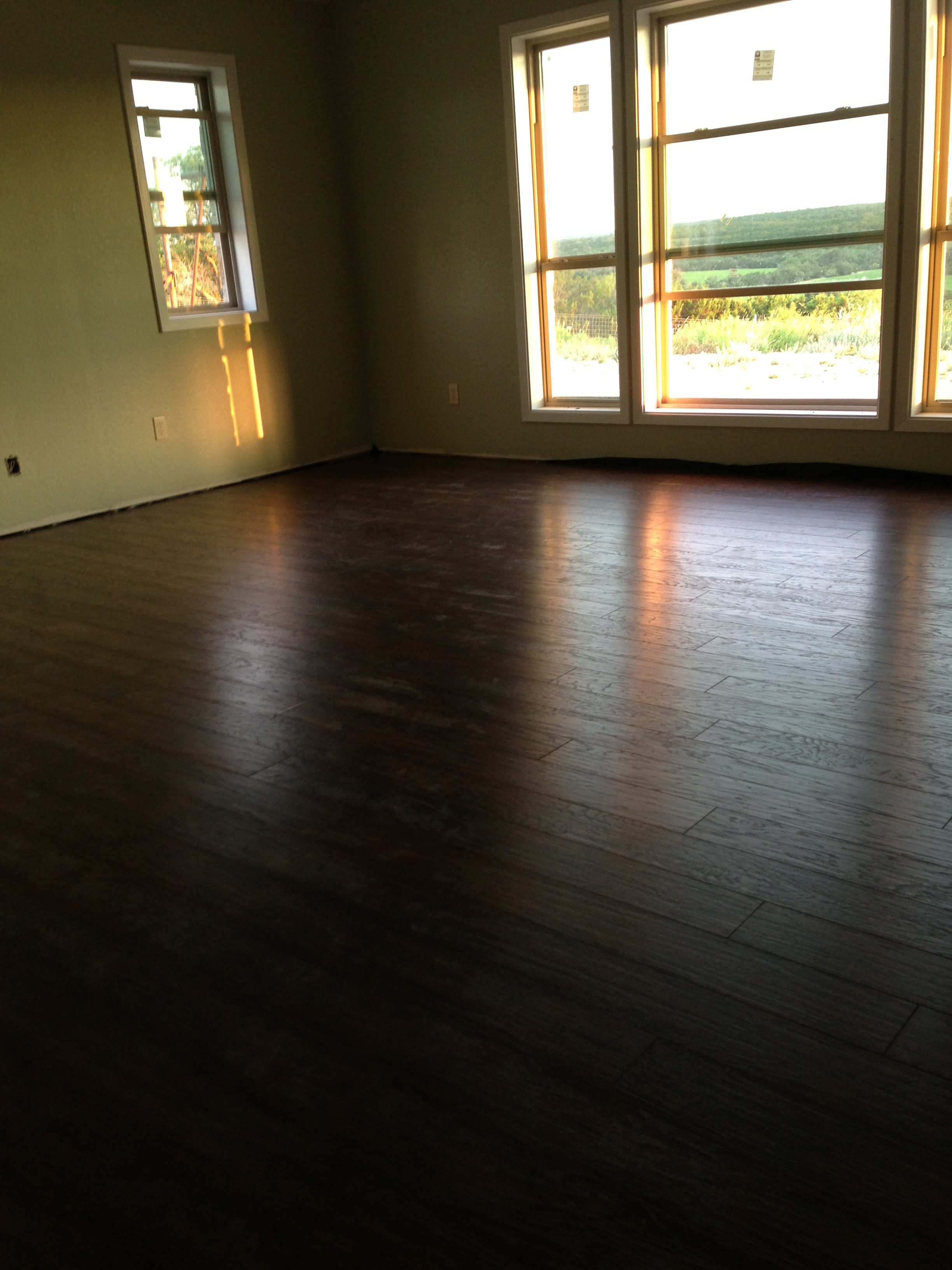 Master bed. We really like the dark floors, but do see that sweeping will be a constant chore..