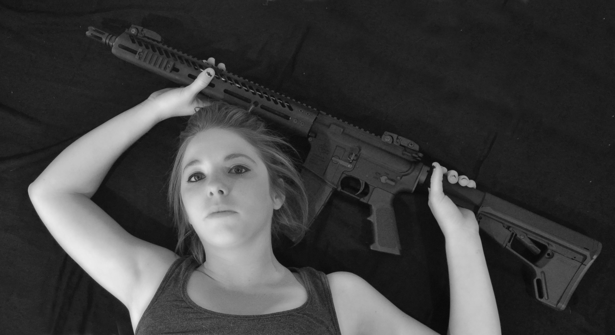 I have included an image of myself. Pictured here is an AR 15 that my husband built. I was asked why this is empowering to me. I have to answer by saying that there is something about standing face on to a target lifting the sights to my eye taking aim and pulling the trigger. The challenge of hitting in the proper place and the ability to look back to a smiling husband. This is only one of many things that make me feel empowered.