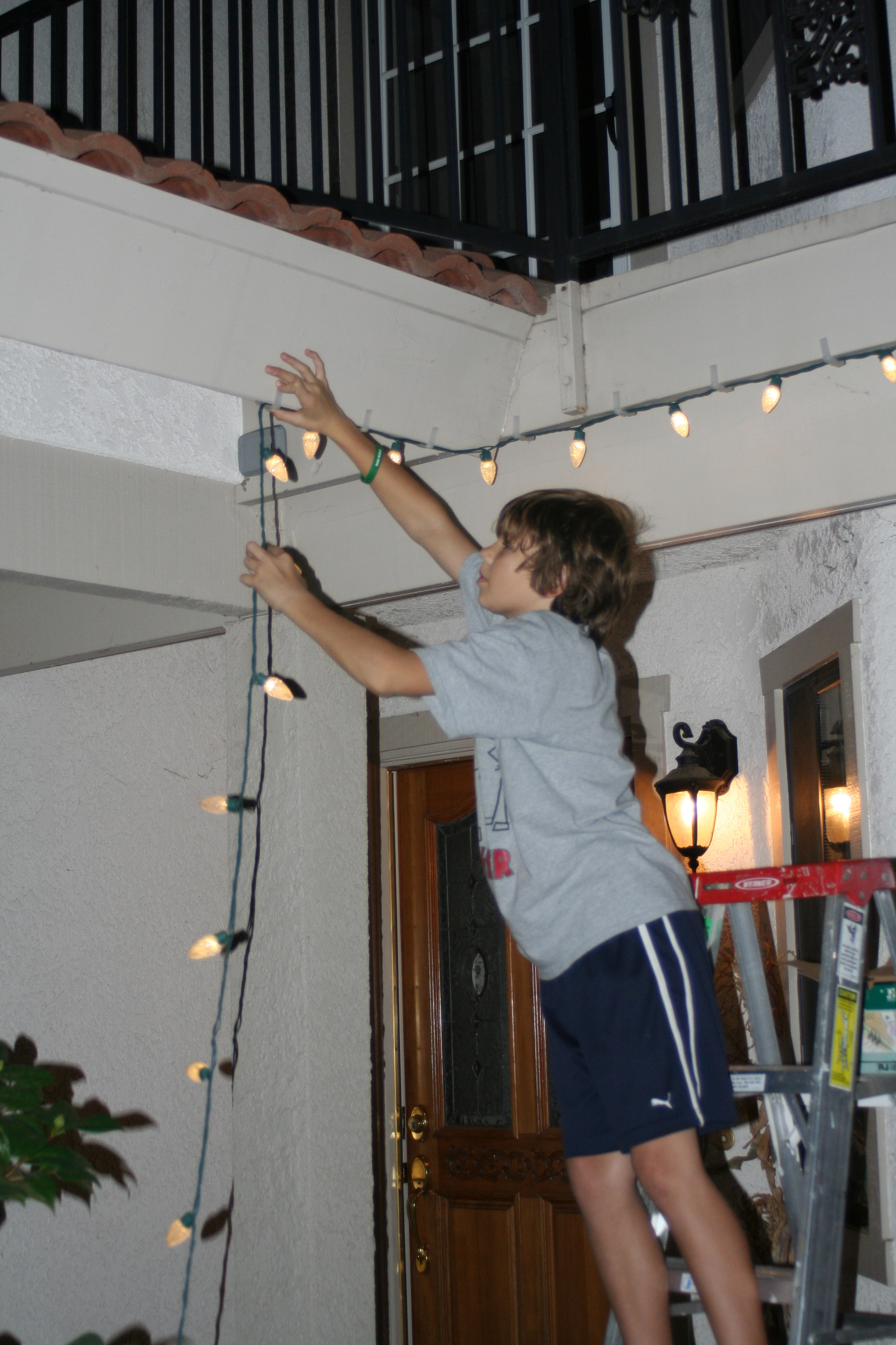 Jacob and I got the lights hung outside. Such a great helper!