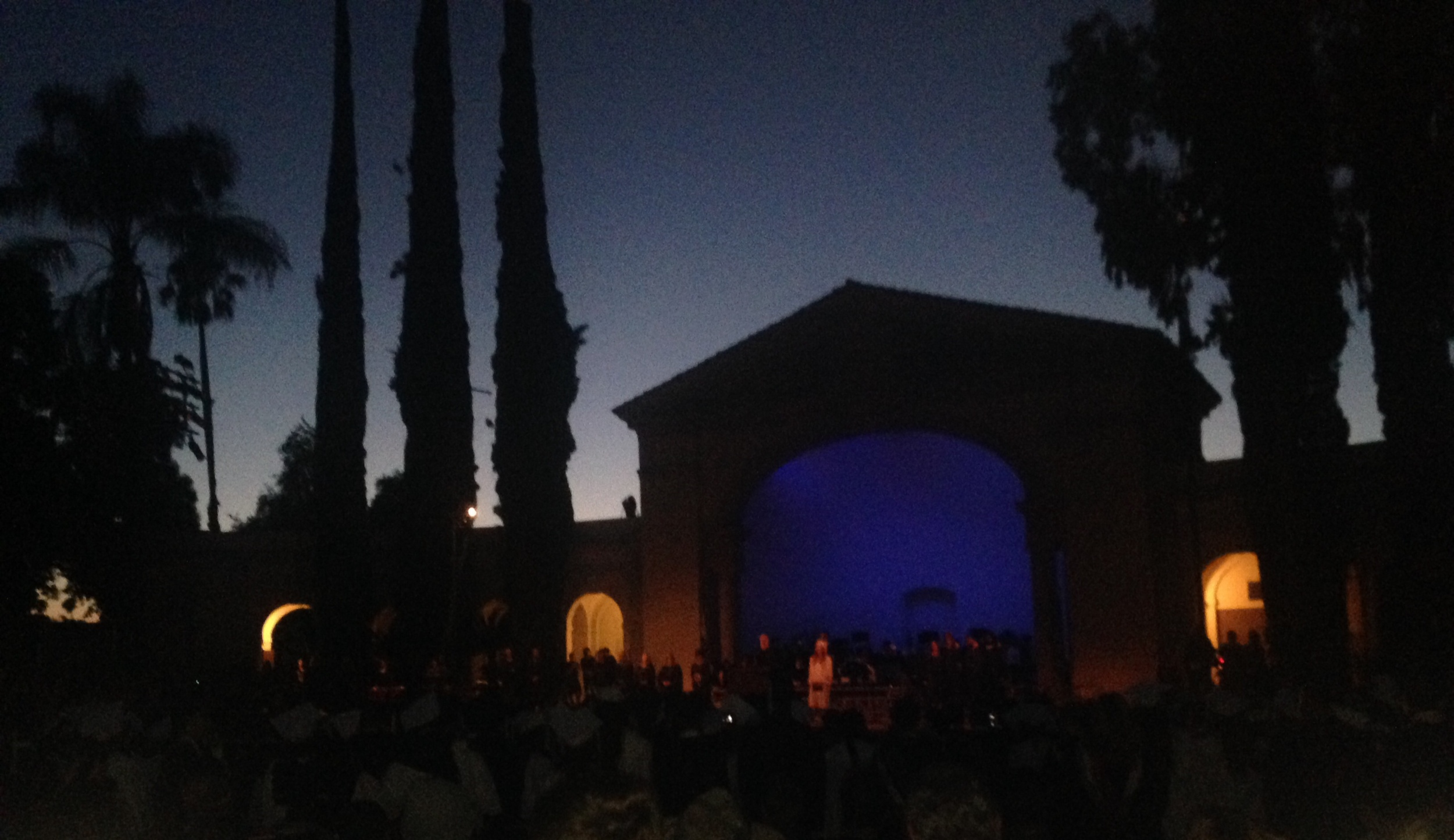 At the end of the ceremony, they dim the lights and the church bells a few blocks away ring out the alma mater.