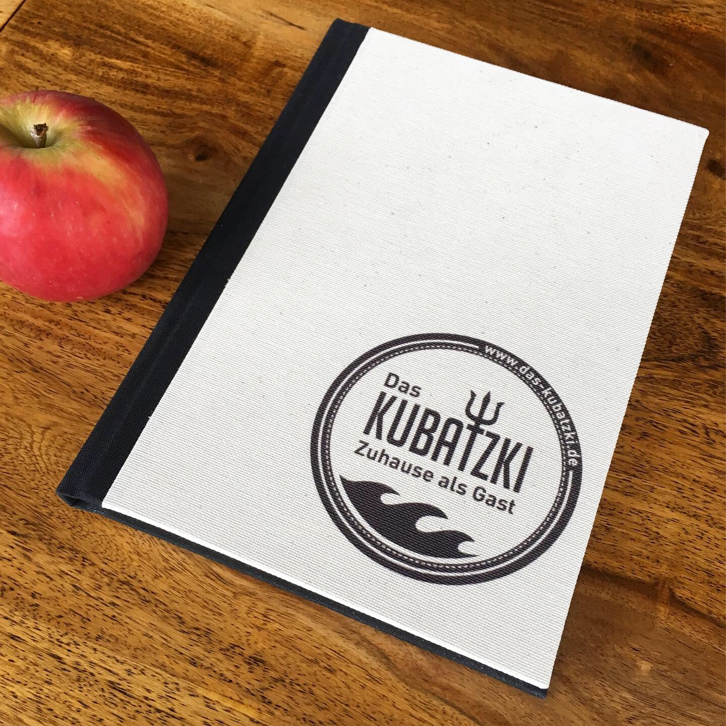 Personalised guest book with company logo printed onto natural ivory linen.