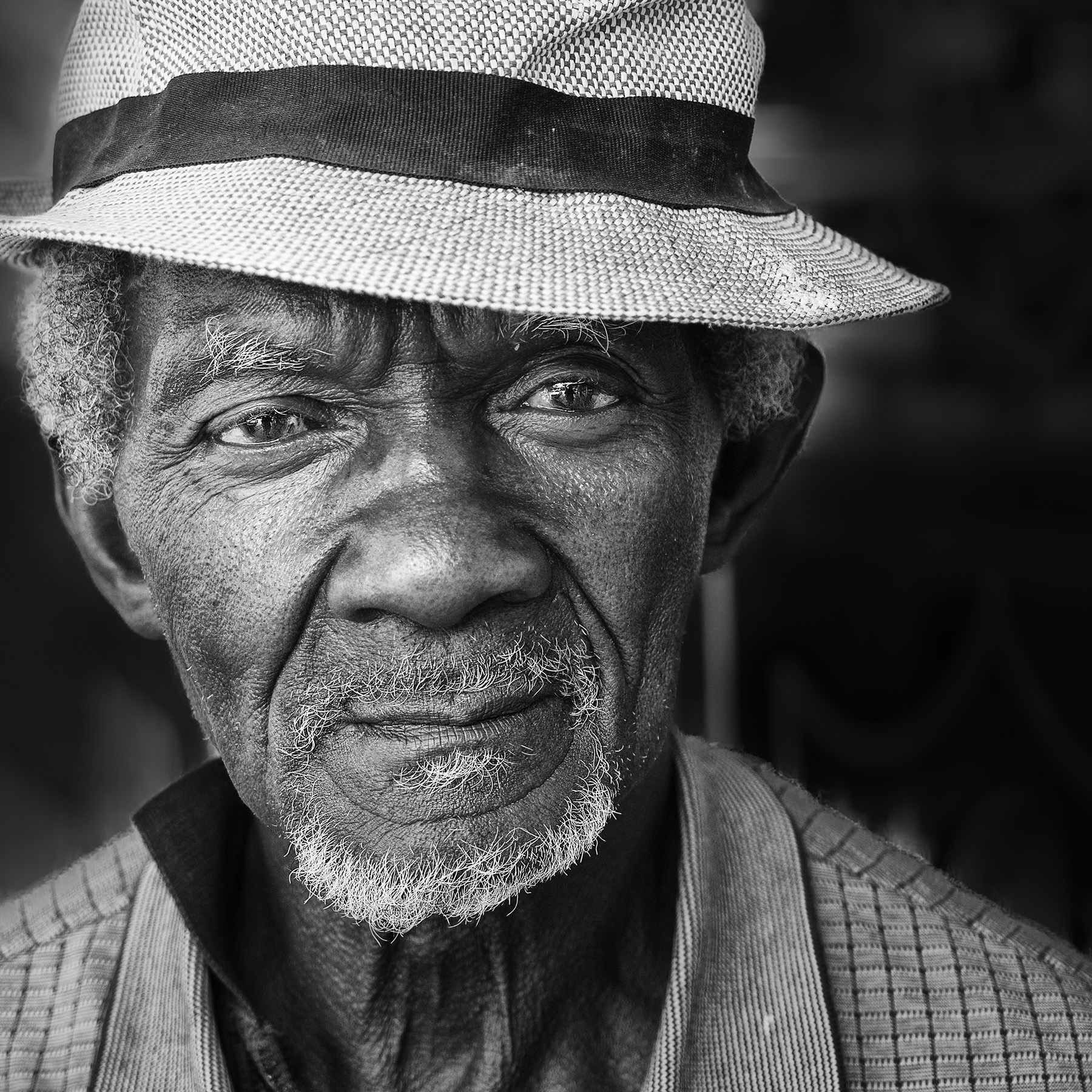 I saw Sam walking into a cut rate liquor store. I could not resist, so I waited outside for about 5 minutes to meet him. He was happy to be photographed and proud to be born and raised in Sarasota.  Bob
