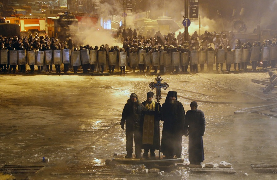 An Associated Press photo of priests intervening in riots in Kiev in January of 2014. ( via Huffington Post )
