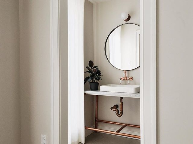 Help from @michael4macd with the vanity design, custom made with 40mm copper pipe, our custom made copper light, carerra marble top and cotton linen window dressings.  #830fisher #residentialarchitecture #custombuilders #highendhomes #advancedbuilders #ottawa