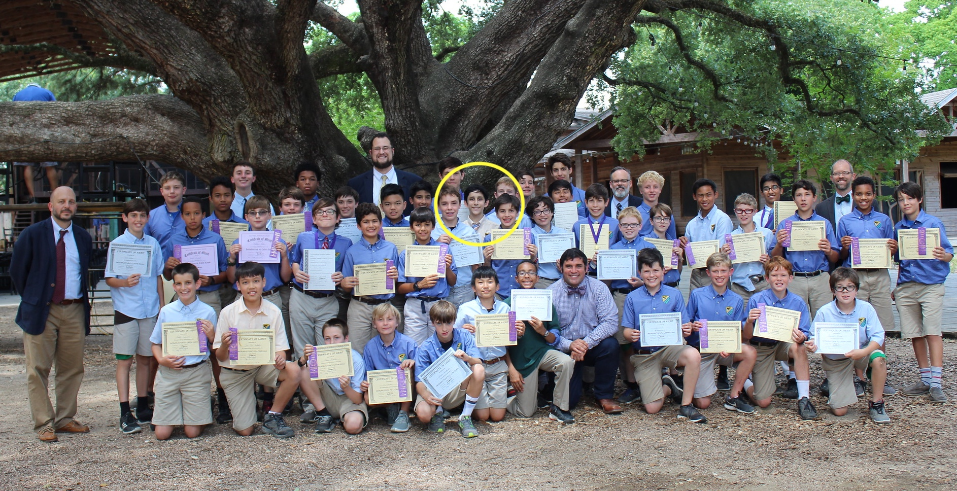 "Martin Saenz (circled in middle) among the ""throng"" of middle school students receiving National Latin Exam awards this year at Western."