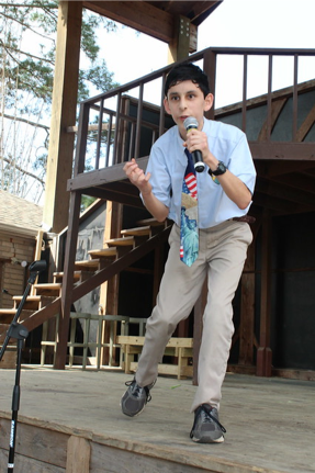 "Martin performing ""The Bear Hunt"" by Abraham Lincoln, winning the 8th grade poetry Bard at the Annunciation Day Festival competition 2019."