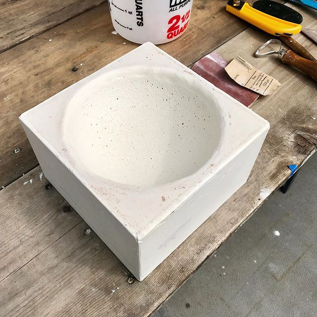 More process! Simple mold for a vessel composed of ball bearings. Feeling the accidental texture from the styrofoam positive left in the plaster. #sculpture #plaster #process #texture #art #design