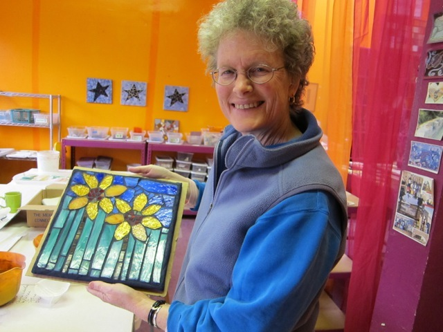 Introduction to Glass Mosaics student with her work