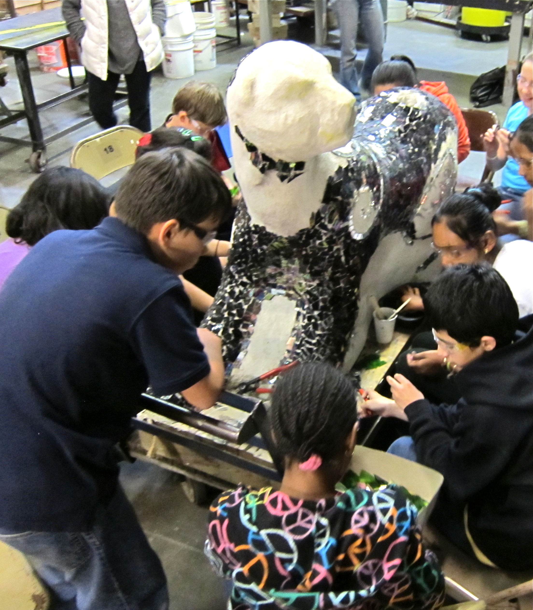 Edna Brewer students create the glass mosaic panther. Project by Rachel Rodi