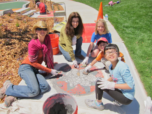 Community participants grout mosaics at Balboa Park. Project led by Rachel Rodi