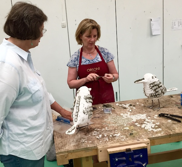 """Sonia King (let) counsels Shona Lockhart on her 3-D """"Crows""""project during a summer course at West Dean."""