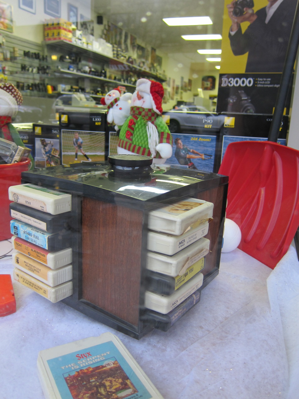 8-Tracks in a camera shop window - if these people sold metaphors, they'd be millionaires.