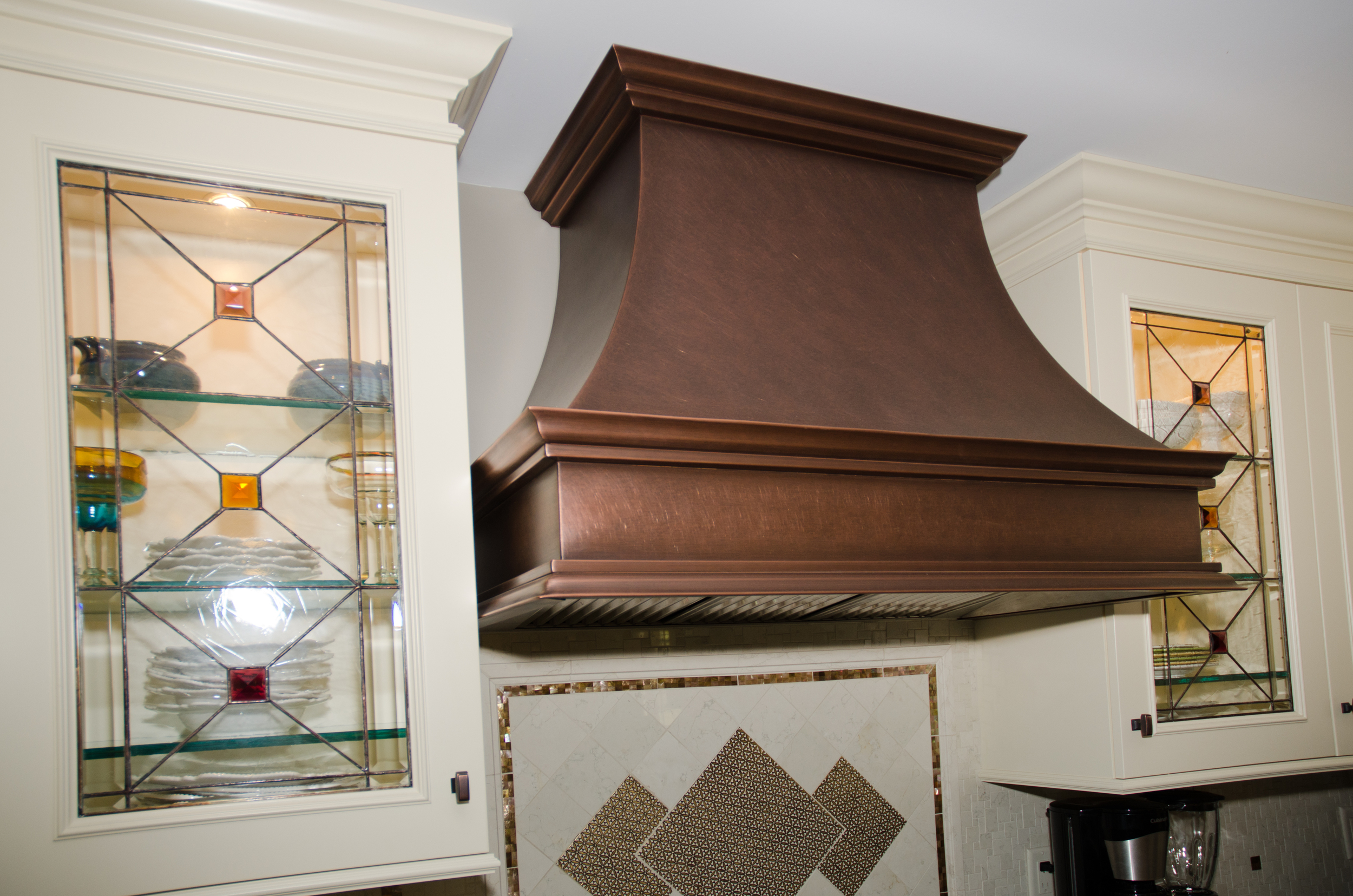Wood Mode kitchen installation by Groundswell Contracting with Range Craft copper range hood