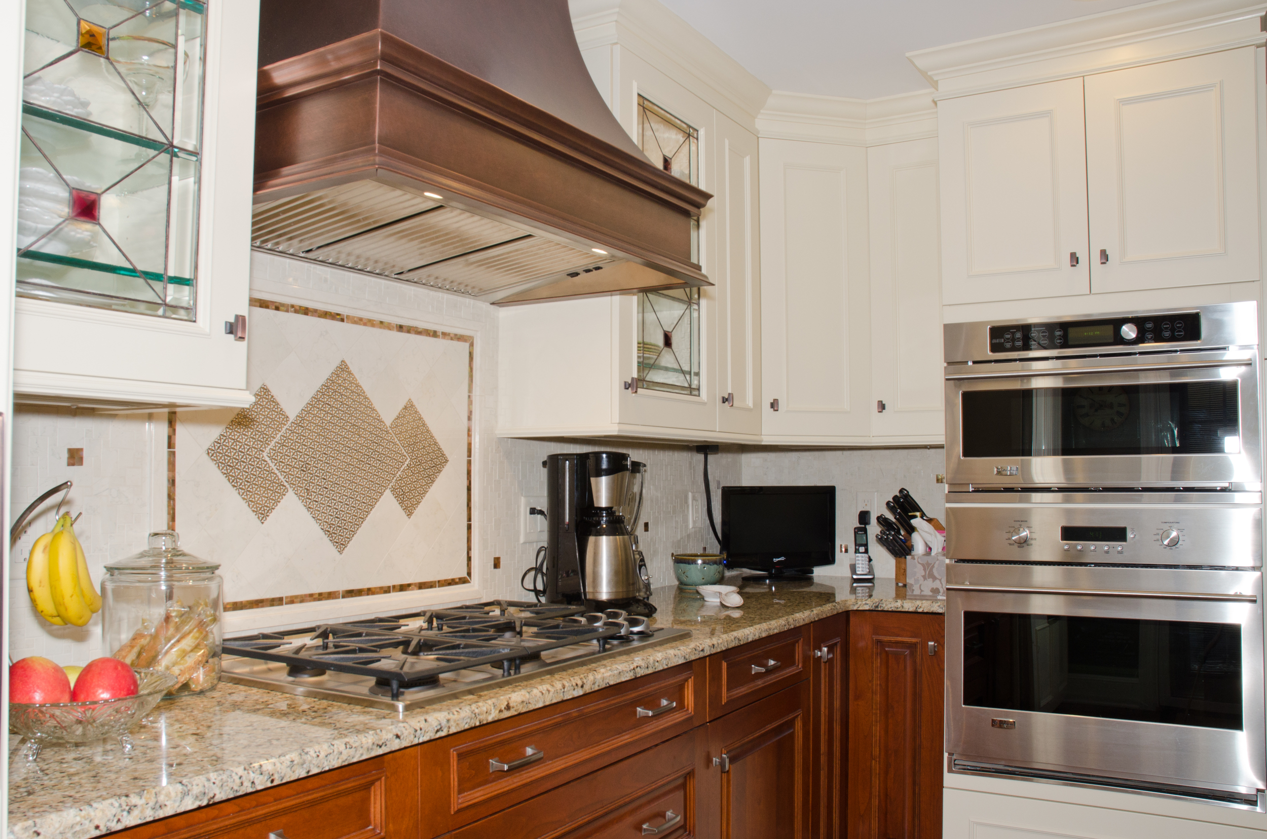 Fire and smoke damaged Wood Mode kitchen after restoration by Groundswell Contracting