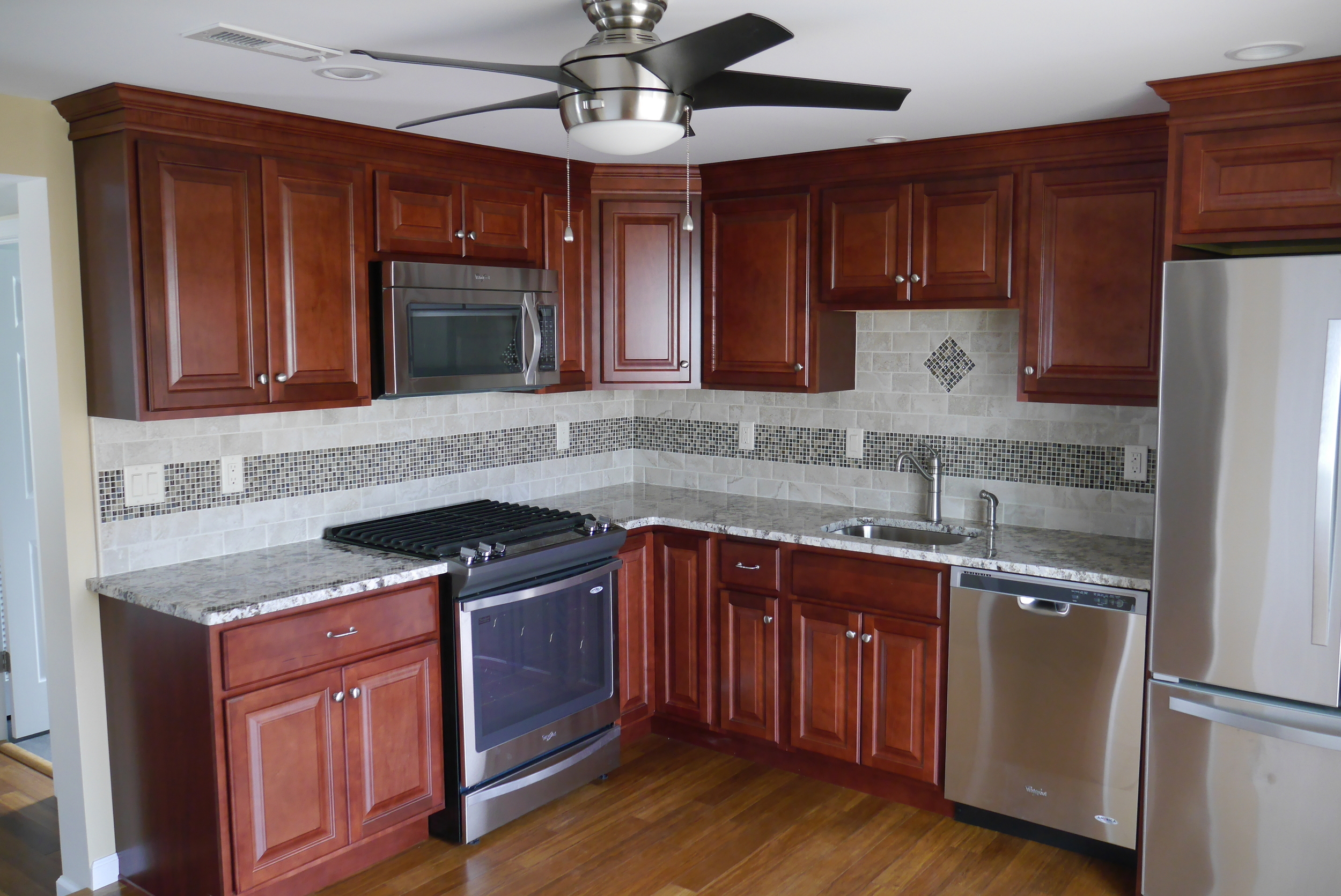 Fire damaged kitchen after restoration by Groundswell Contracting