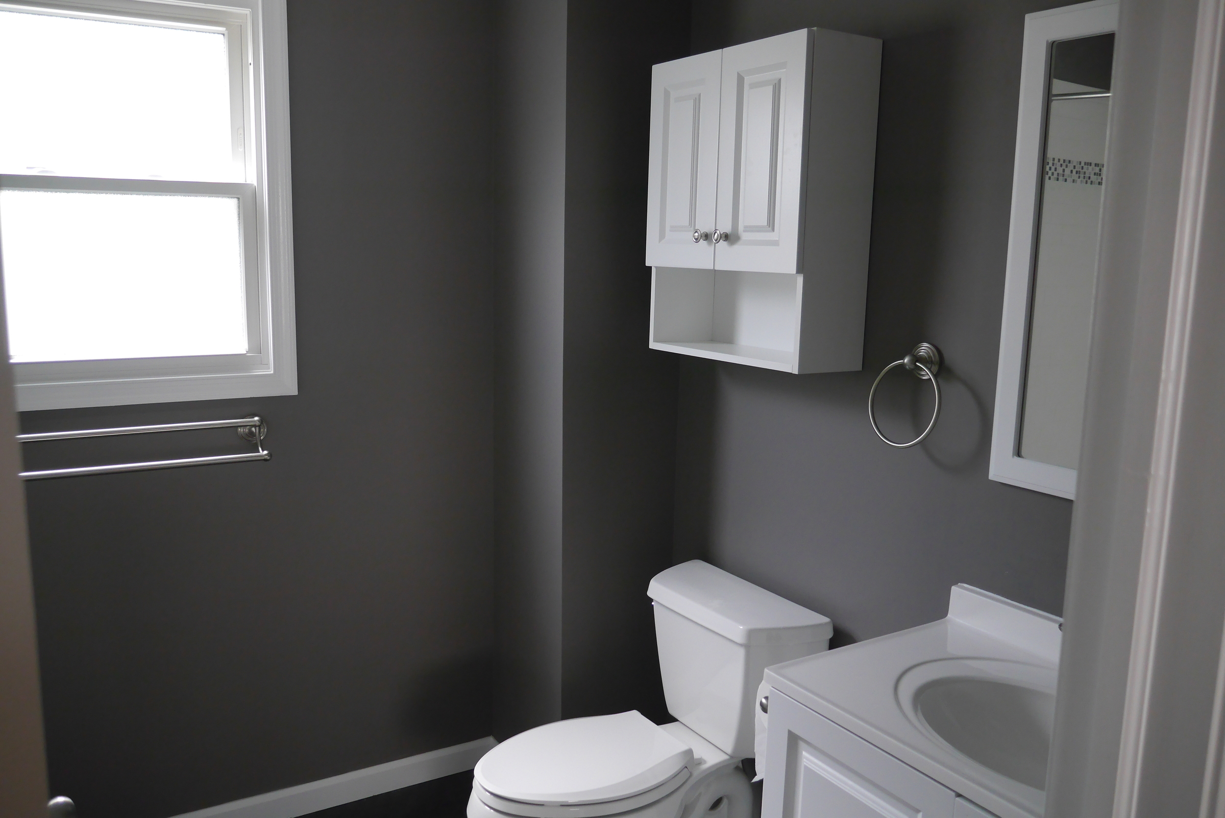 Smoke damaged bathroom after restoration by Groundswell Contracting