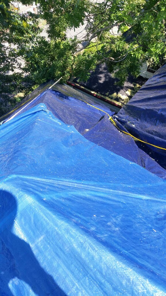 Roof tarping by Groundswell Contracting