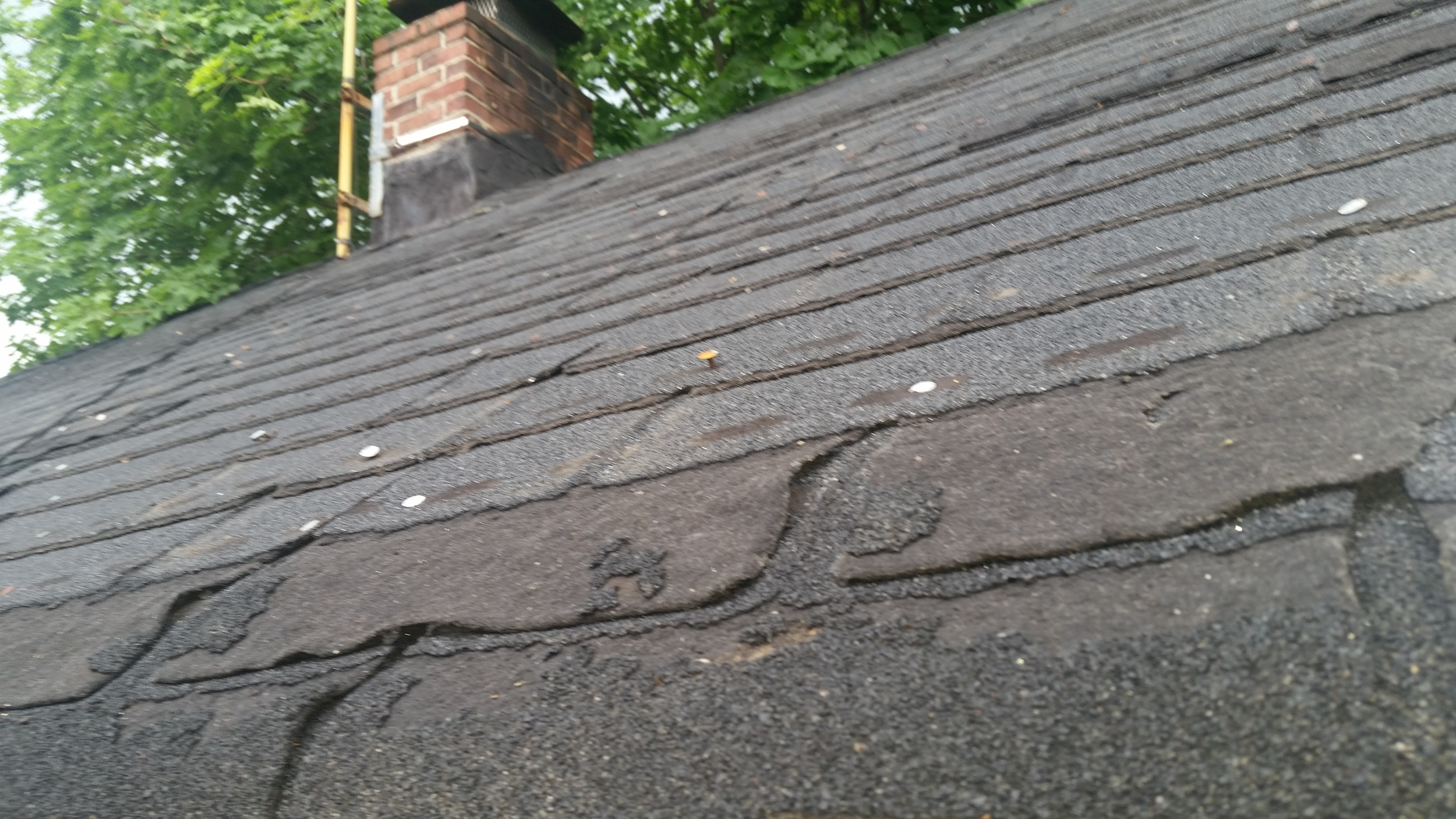 Roof before replacement by Groundswell Contracting