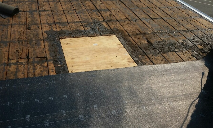 Flat roof during replacement by Groundswell Contracting