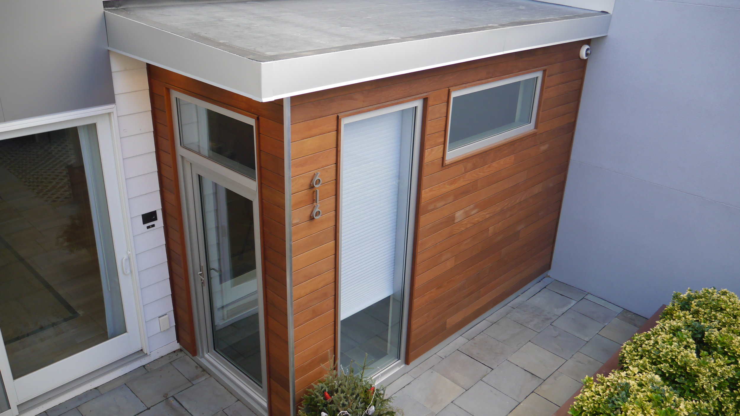 Custom addition with Mataverde Ipe siding. Installation by Groundswell Contracting