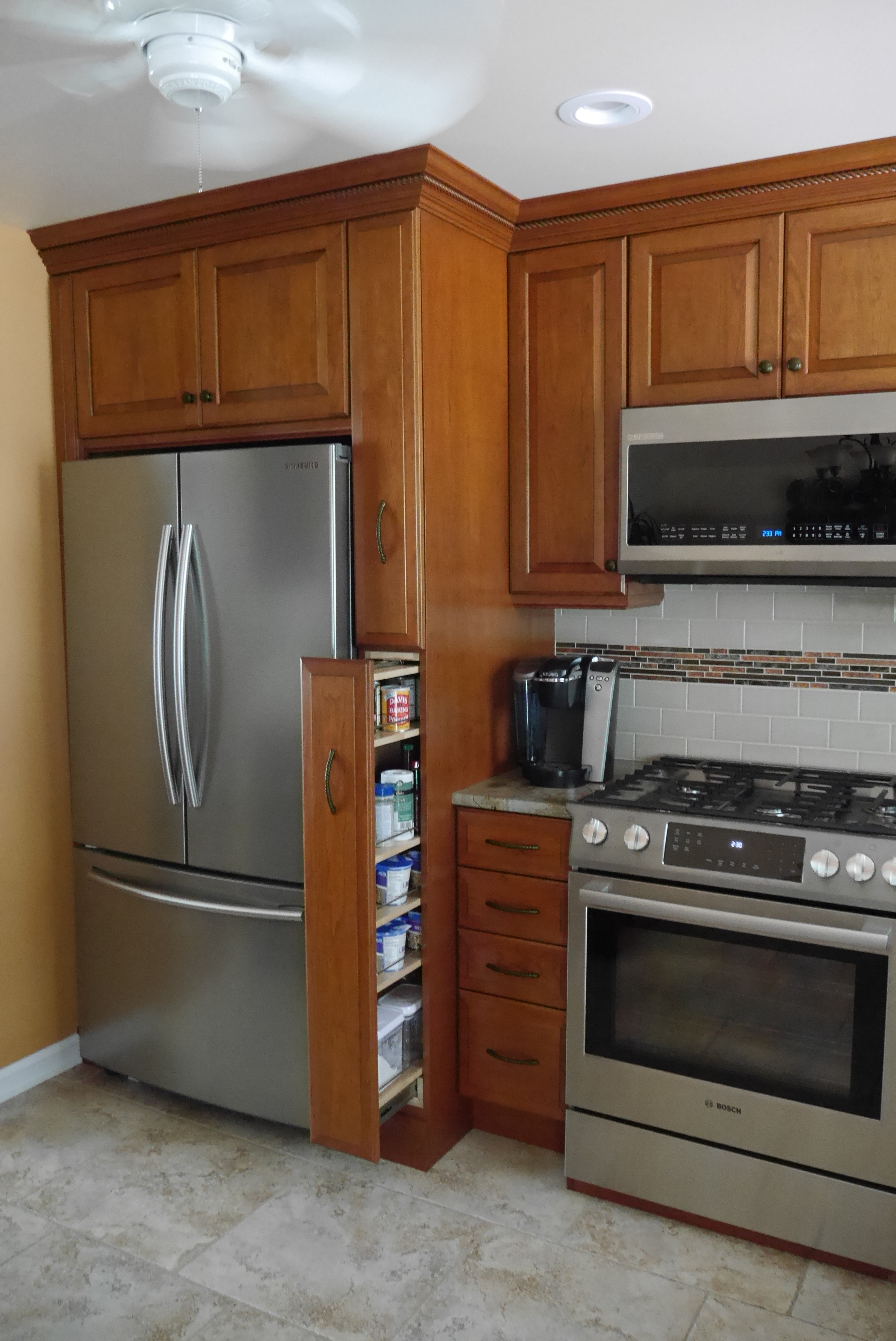 Adelphi custom kitchen with full height spice cabinet after installation by Groundswell Contracting
