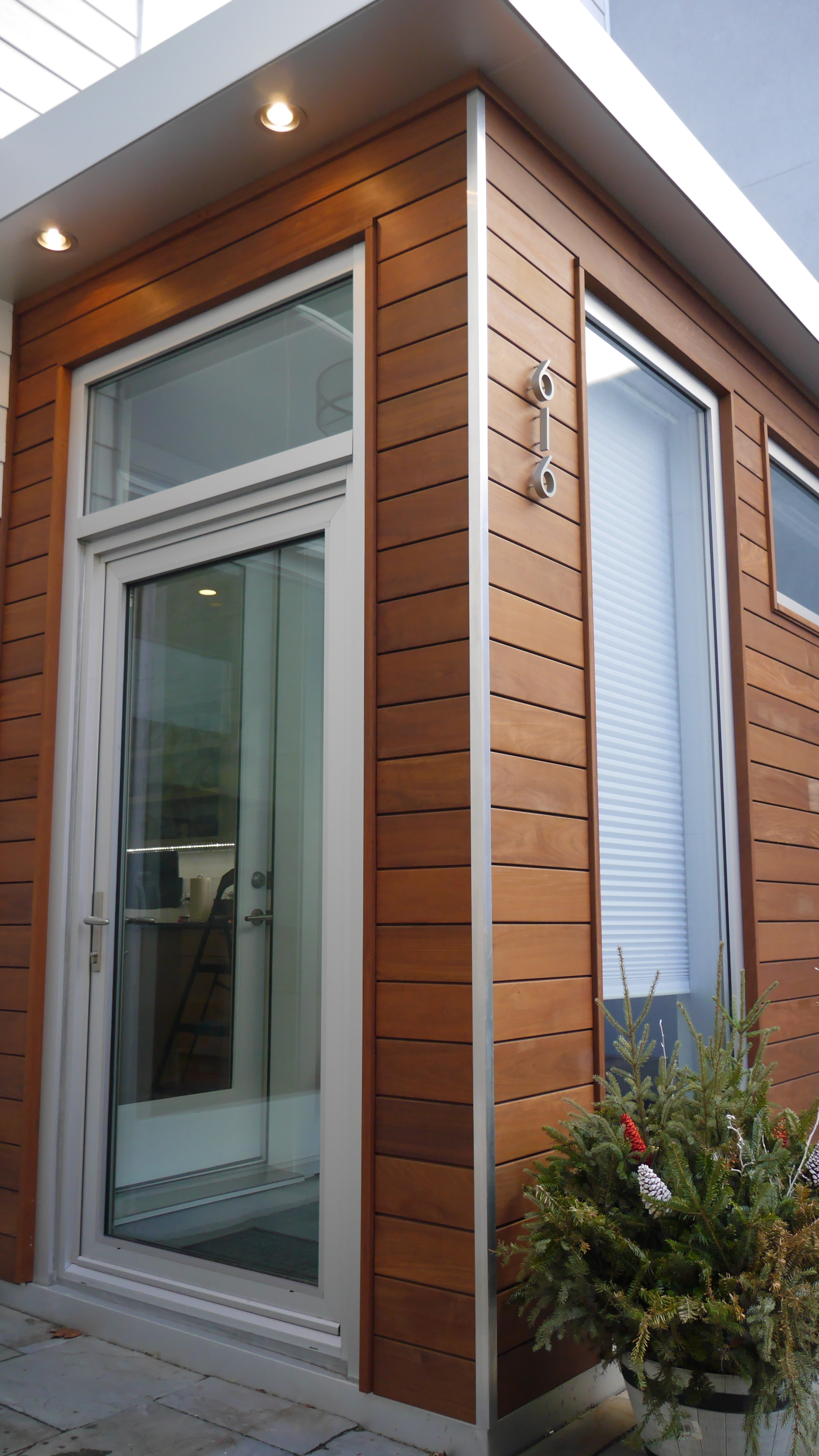 Mataverde Ipe Siding installation by Groundswell Contracting with anodized aluminum finishes