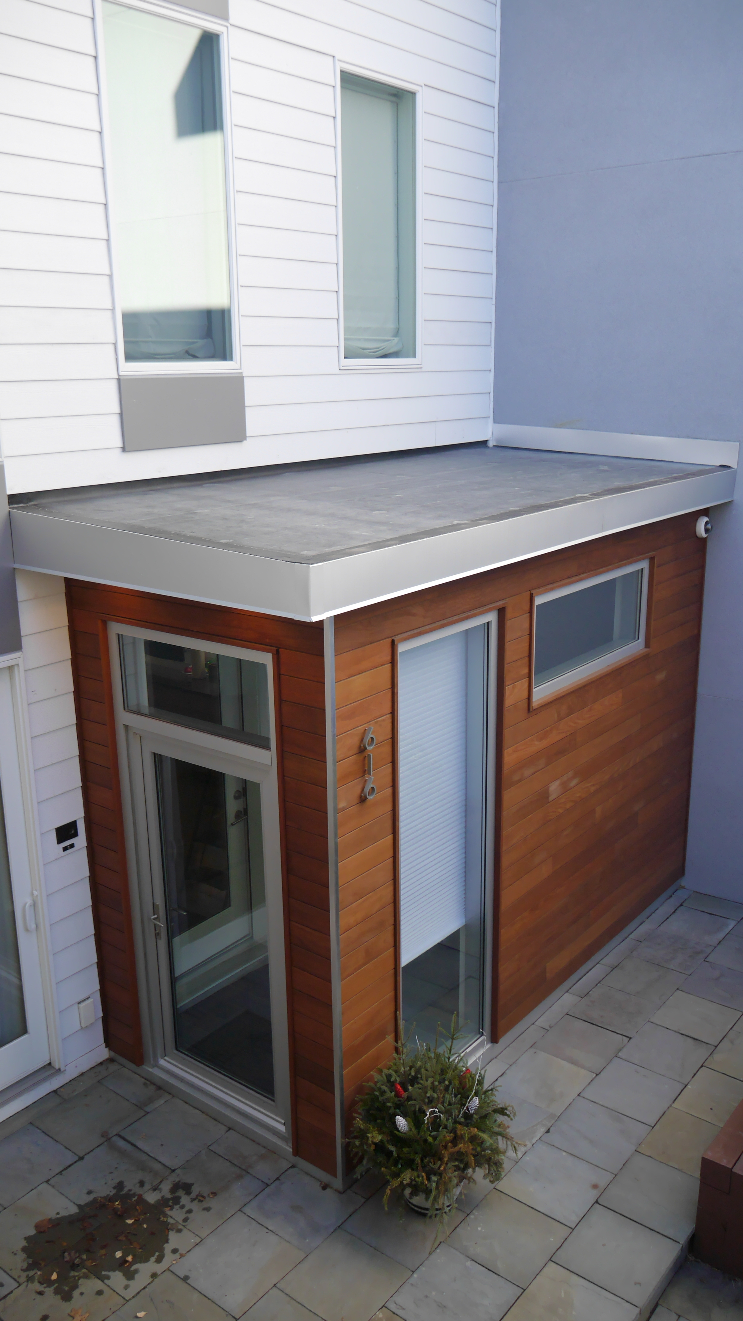Mataverde Ipe Siding installation by Groundswell Contracting with EPDM roofing and anodized aluminum finishes