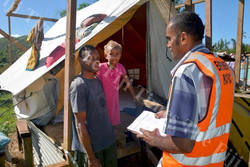 Empower Pacific's senior counsellor Harrison Kautoga, right, talks to the turaga-ni-koro, Penasio Waqa, and his daughter Karalaini Natabua at Navuniyaumunu Village in Ra during a counselling sesson. Picture: JAI PRASAD