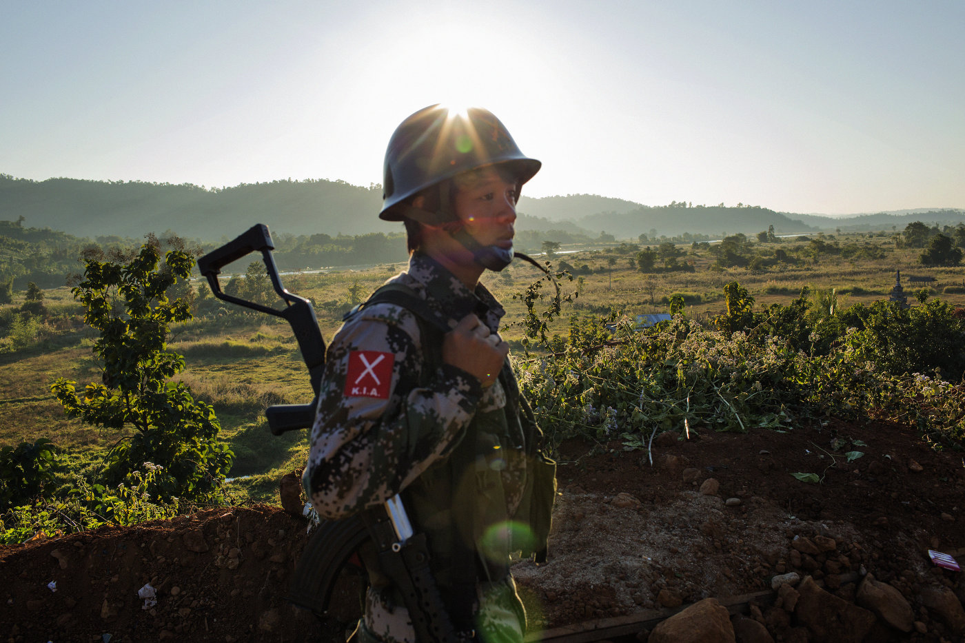 Kachin Independence Army (KIA) soldiers patrol near the village of Lajayang, a place of recent fighting, outside of Laiza, Kachin State in northern Myanmar.