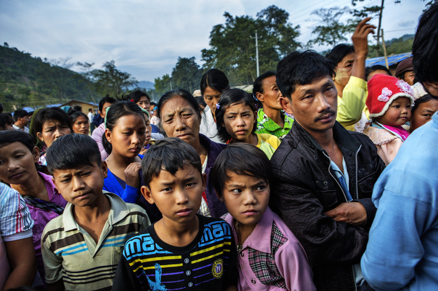 Internally displaced refugees wait for food stamps to be handed out in Jeyang outside of Laiza, in KIA controlled territory of Kachin State in northern Myanma.