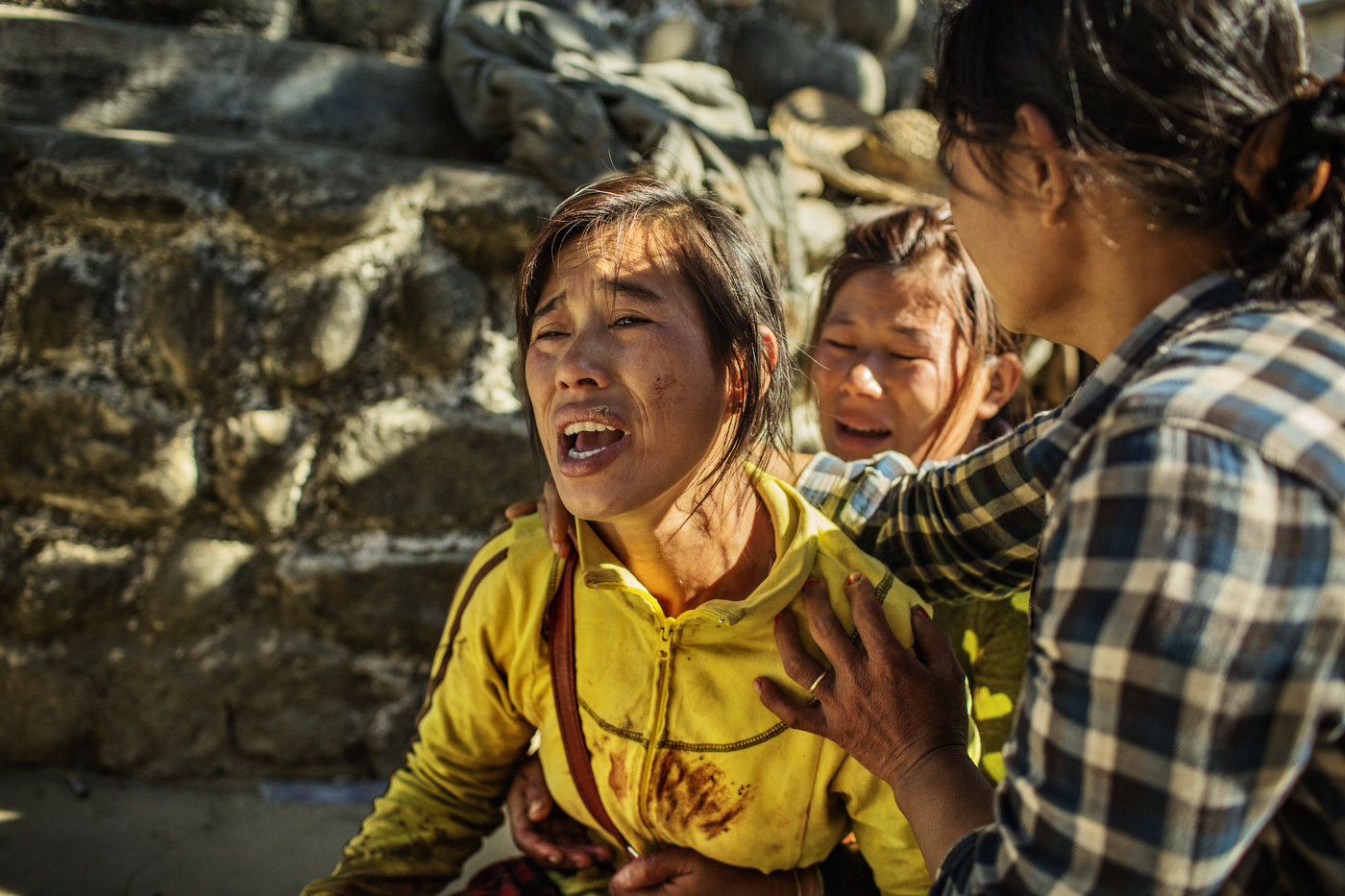 The wife of deceased Maji Tu Ja, 40, mourns outside the Hospital in Laiza, Kachin State in northern Myanmar.     Maji Tu Ja (Maji is the family name) was a farmer and village militiaman who was killed by a Burmese Army mortar grenade whilst repairing his tractor in a field. Three other civilians were wounded in the same mortar attack - two of them seriously.