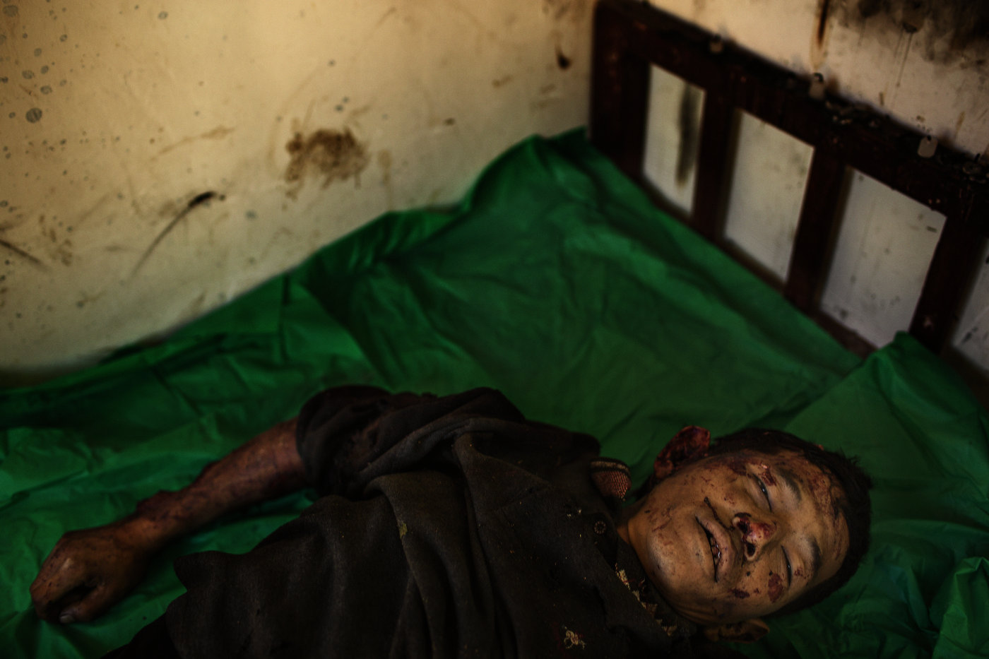The body of deceased Maji Tu Ja, 40, lies in a mortuary in Laiza Hospital in Kachin State in northern Myanmar. Maji Tu Ja was killed by a Burmese Army mortar grenade whilst repairing his tractor in a field. Three other civilians were wounded in the same mortar attack - two of them seriously.