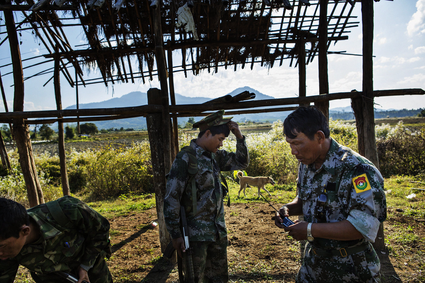 KIA soldiers patrol a few kilometers from where Burmese heavy artillery are shelling the small town of Namsangyang. Later that day, KIA forces had to give up the town which sits on an important road leading to the rebels' main town of Laiza.
