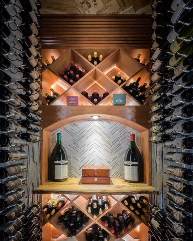 Wine room Wednesday! A shot of a wine room as a part of our Memorial Dr remodel.  Designer: @eklektik_interiors  PM: Andrew Pudlo  #wineroom #custombuilder #apbuilders #finehomebuilding #houstonbuilder #liveedgewood #winerooms