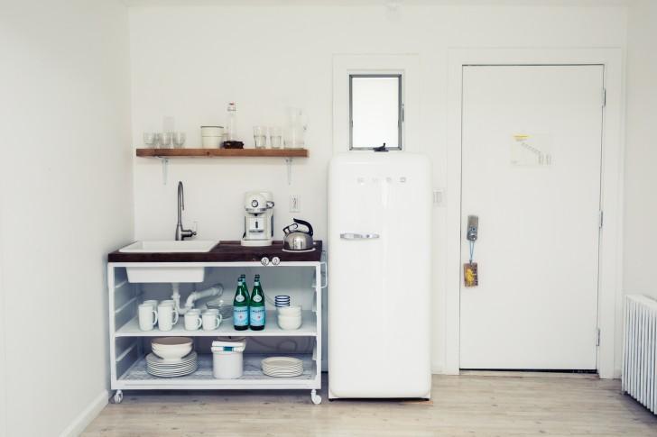 simple white kitchen with a smeg