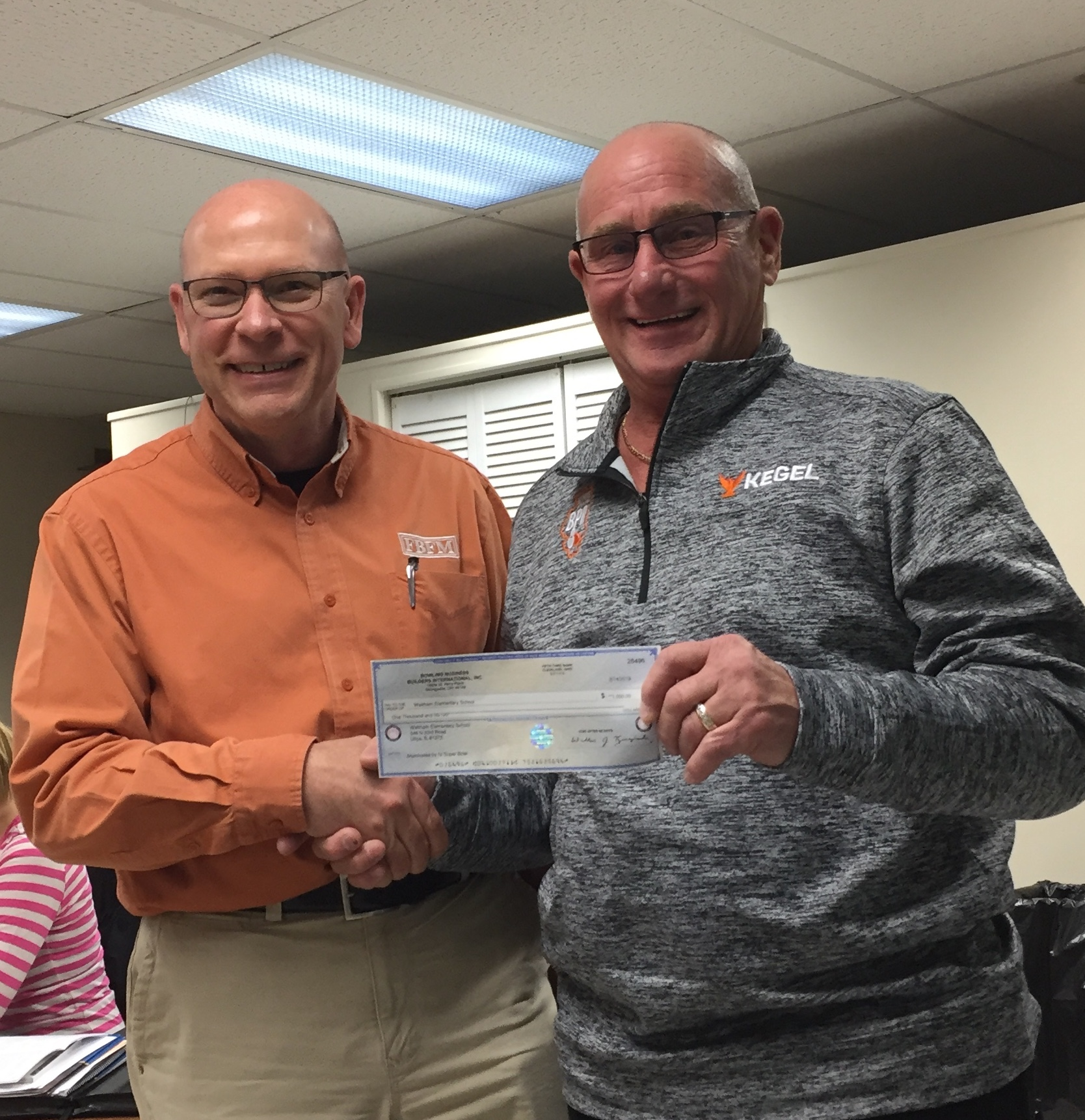 "Bob Stubler presented Jim McCabe (Waltham School Board President) a check for a $1,000.00 from  the ""Kids Bowl Free"" program."